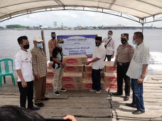 Jelang Idul Fitri 1442 H, Sambu Group Bagi-bagi Biskuit ke Masyarakat