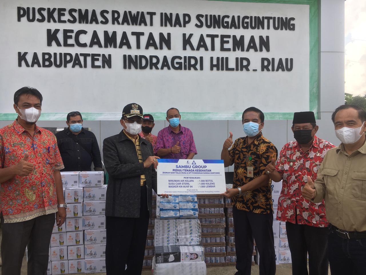 Sambu Group Sumbang 1000 Botol Minuman Air Kelapa, 1000 Kaleng Susu Cair dn 1000 Masker Untuk Nakes